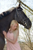 Dark horse and woman — Stock Photo