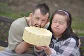 Couple with birthday cake — Stock Photo
