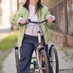 Woman ridding Trike — Stock Photo #44296673