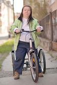 Woman ridding Trike — Zdjęcie stockowe
