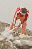 Man and sledge-hammer — Stock Photo