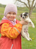 Little girl with her puppy — Stock Photo