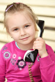 Baby with old vintage phone — Stock Photo