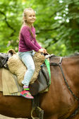 Girl ridding horse — Stock Photo