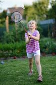 Cute little girl playing badminton — Stock Photo