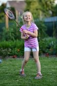 Cute little girl playing badminton — Stock Photo