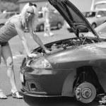 Girl posing at sports car. — Stock Photo #49959801