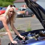 Girl posing at sports car. — Stock Photo #49959819