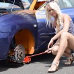 Girl posing at sports car. — Stock Photo #49959845