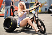 Woman on a tricycle outdoors — Stockfoto