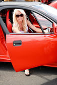 Woman sitting in the sport car — Foto de Stock