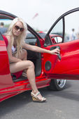 Woman sitting in the sport car — Stock Photo