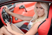 Woman sitting in the sport car — Stok fotoğraf