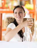 Woman drinking white wine — Stock Photo