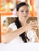 Woman drinking white wine — Stock Photo