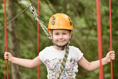 Girl climbing in the trees — Stock Photo