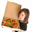 Portrait of young woman with pizza isolated on white — Stock Photo #9157067