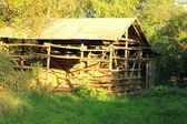 Wooden barn with hay — Stock Photo
