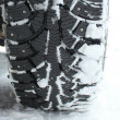 Winter tire in snow — Stock Photo #13435063
