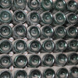 Stock Photo: Stacked up wine bottles in cellar