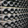 Stacked up wine bottles in cellar — Stock Photo #17589265