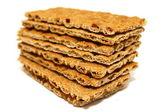 Biscotti genuini con cereali isolato su bianco — Foto Stock