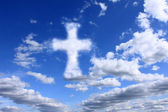 Religious cross on cloudy sky — Foto de Stock