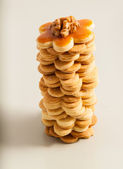 Tower of homemade butter cookies with caramel and nut, top view — Stock Photo