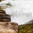 Stock Photo: Wet wooden stairs with whitewater splash