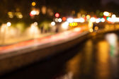 Bokeh of city lights with reflections in a river — Stock Photo