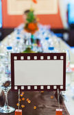 Movie film sign for an official dinner table — Stock Photo