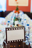Movie film sign for a wedding dinner table — Stock Photo