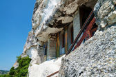 Orthodox monastery excavated in the rocks view from below — Stock Photo