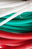 White, green and red cable hoses — Stock Photo