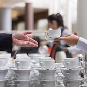 Offering a coffee — Stock Photo