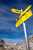 Yellow sign-board against mountain scenery — Stock Photo