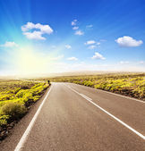Asphalt road to the sun — Stock Photo