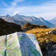 Navigate with map in the mountain — Stock Photo