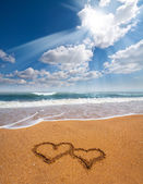 Hearts drawn on the sand of a beach — Stock Photo