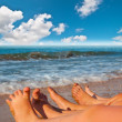 Bare feet of children on the beach — Stock Photo #37940527
