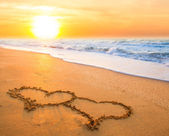 Two hearts on beach sand — Stock Photo
