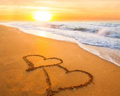 Two hearts on beach sand — Foto de Stock