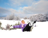 Happy little kid is playing in snow — Стоковое фото