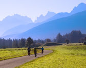 Group of cyclists biking in mountains — Stock Photo
