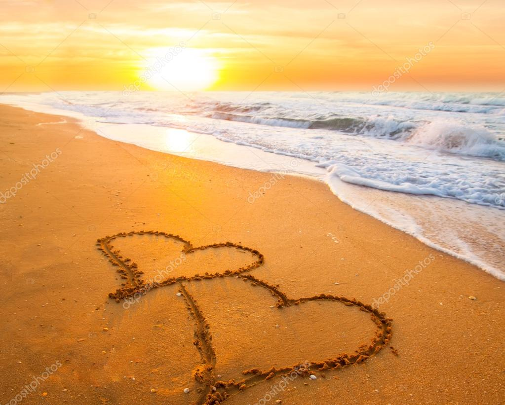 Two hearts on beach sand — Stock Photo © Kotangens #39820897