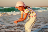 Happy active child splashing and playing in sea. — Stock Photo