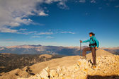Tourist woman on the top of mount, — Stock Photo