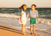 Photo of happy children on the beach — Stock Photo