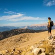 Tourist woman on the top of mount, — Stock Photo #46114241