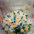 Stock Photo: The bodice bridesmaid dresses and bridal bouquet close-up.